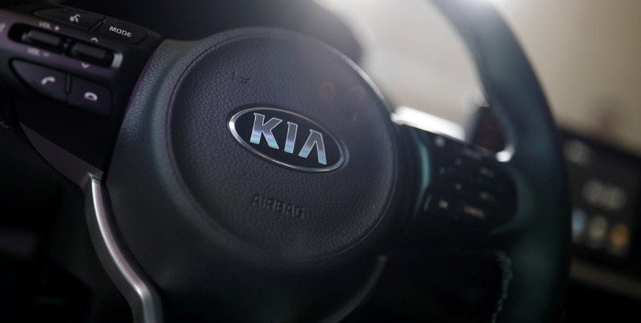 The logo of Kia Motor is seen on a steering wheel of new Morning compact car during its unveiling ceremony in Seoul, South Korea, January 17, 2017.  REUTERS/Kim Hong-Ji