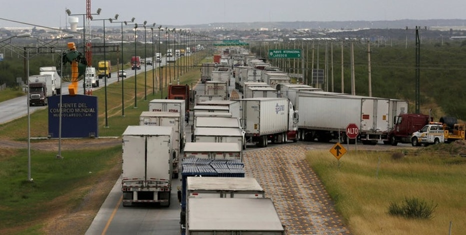 FILE PHOTO - Trucks wait in a queue for the border customs control to cross into U.S. at the World Trade Bridge in Nuevo Laredo, Mexico on November 2, 2016.  REUTERS/Daniel Becerril/File Photo