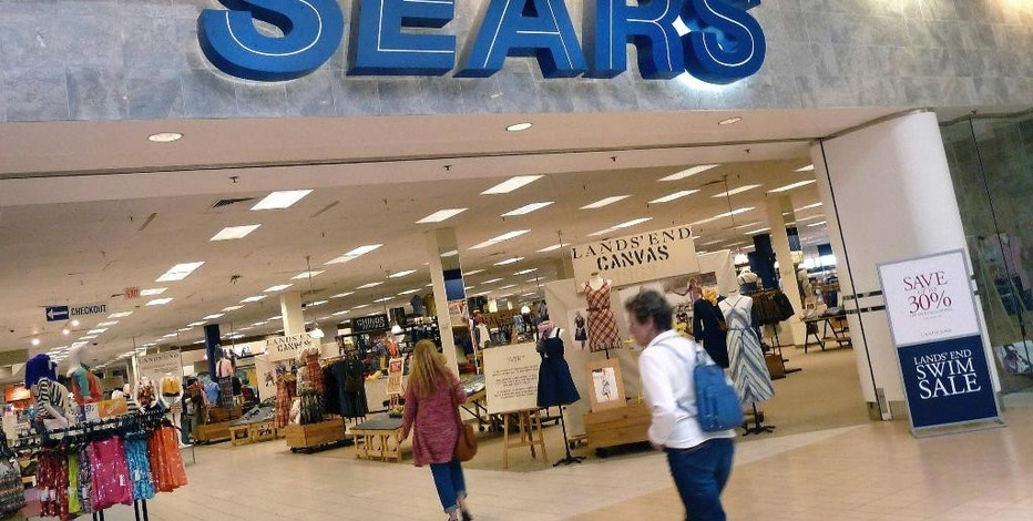 FILE - In this Thursday, May 17, 2012, file photo, shoppers walk into Sears in Peabody, Mass. The troubled department store chain, says it may sell more of its real estate, cut more jobs and sell more of its famous brands as it seeks to make a profit. The company, which also runs Kmart stores, wants to cut costs by at least $1 billion a year. Shares of Sears Holding Corp., which are down 40 percent this year, soared 45 percent before the stock market opened Friday, Feb. 10, 2017. (AP Photo/Elise Amendola, File)