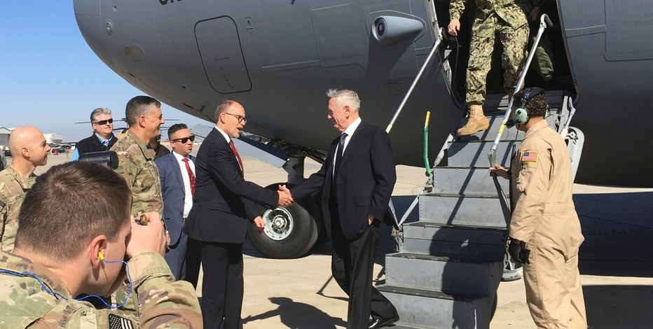 U.S. Secretary of Defense Jim Mattis, center, is greeted by U.S. Ambassador Douglas Silliman as he arrives at Baghdad International Airport on an unannounced trip Monday, Feb. 20, 2017. Mattis said Monday the United States does not intend to seize Iraqi oil, shifting away from an idea proposed by President Donald Trump that has rattled Iraq's leaders. (AP Photo/Lolita Baldor)