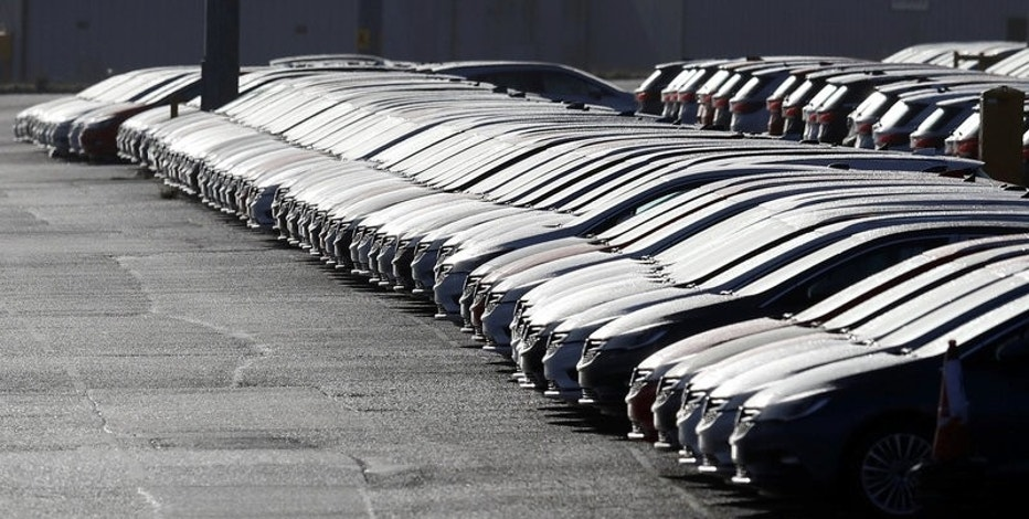 Vauxhall cars are lined up in preparation for delivery outside Vauxhall's plant in Ellesmere Port, Britain, March 6, 2017. REUTERS/Phil Noble