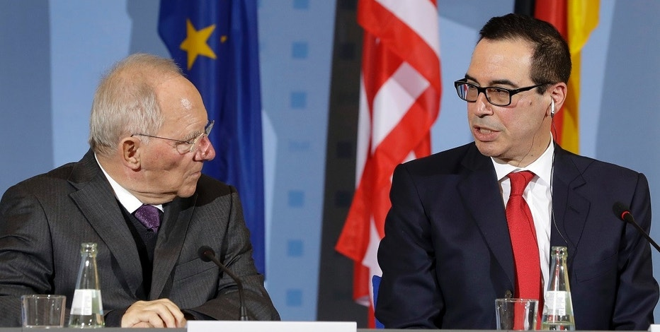 U.S. Treasury Secretary Steven Mnuchin, right, and German Finance Minister Wolfgang Schaeuble, left, address the media during a joint press conference after a meeting in Berlin, Germany, Thursday, March 16, 2017. (AP Photo/Michael Sohn)