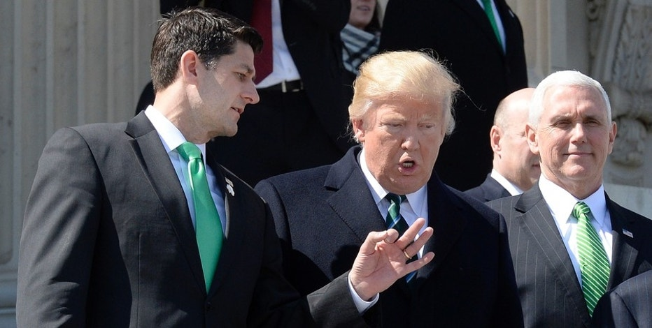 United States President Donald J. Trump, center, and US House Speaker Paul Ryan (Republican of Wisconsin), left, walk down the steps of the US Capitol after attending the Friends of Ireland Luncheon at the U.S Capitol on March 16, 2017 in Washington, DC. US Vice President Mike Pence is at right. Credit: Olivier Douliery / Pool via CNP - NO WIRE SERVICE- Photo by: Olivier Douliery/picture-alliance/dpa/AP Images