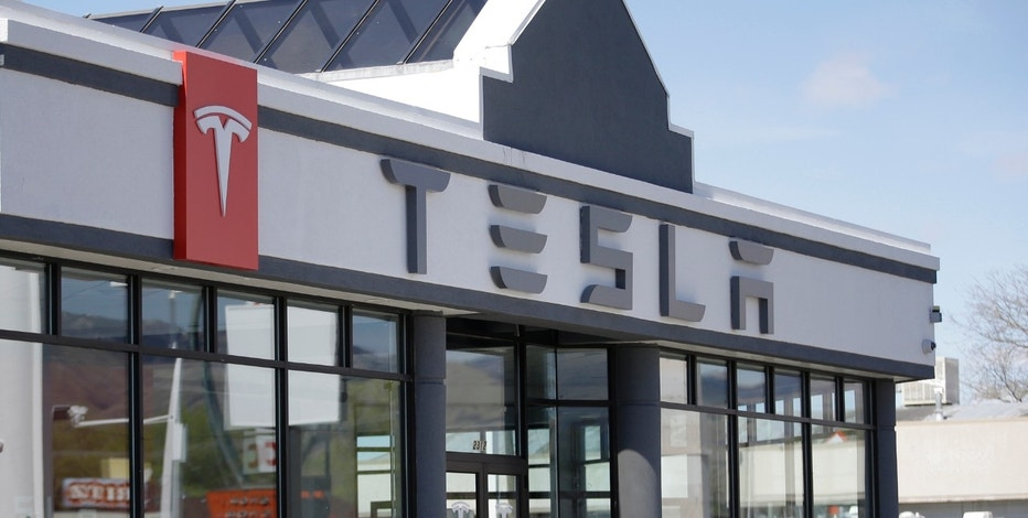 FILE - In this April 1, 2015, file photo, shows the Tesla Motors showroom in Salt Lake City. The Utah Supreme Court has ruled against Tesla in a push to sell its sleek, all-electric vehicles in the state. The court said in an opinion issued Monday, April 3, 2017, that Utah's State Tax Commission was correct in a 2015 decision denying Tesla a license to tell its cars in Utah. The company built a $3 million showroom in Salt Lake City but hasn't been able to sell new cars there because officials decided it would break state laws about car makers owning dealerships. (AP Photo/Rick Bowmer, File)