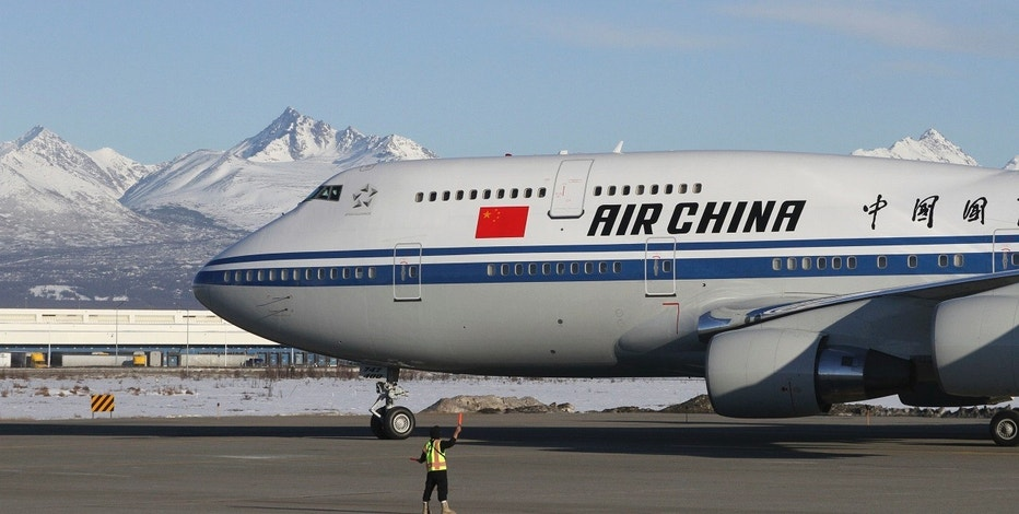 The plane carrying Chinese President Xi Jinping taxies to a stop with the snow-capped Chugach Mountains providing a backdrop Friday, April 7, 2017, in Anchorage, Alaska. During the refueling stop, Xi planned a little sightseeing and a meeting and dinner with Alaska Gov. Bill Walker after spending time earlier in the day with President Donald Trump in Florida. (AP Photo/Mark Thiessen)