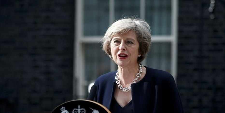Britain's Prime Minister, Theresa May, speaks to the media outside number 10 Downing Street, in central London, Britain July 13, 2016.     REUTERS/Peter Nicholls/File Photo
