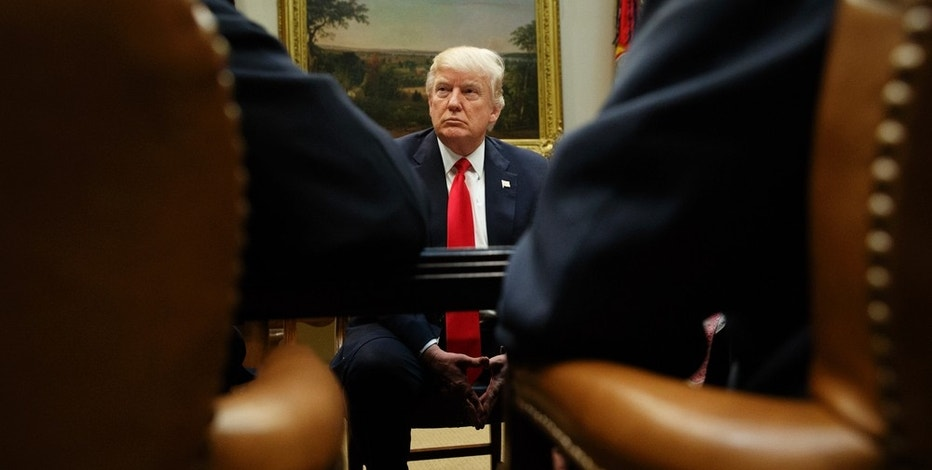 President Donald Trump listens during a meeting with the National Association of Manufacturers, Friday, March 31, 2017, in the Roosevelt Room of the White House in Washington. (AP Photo/Evan Vucci)