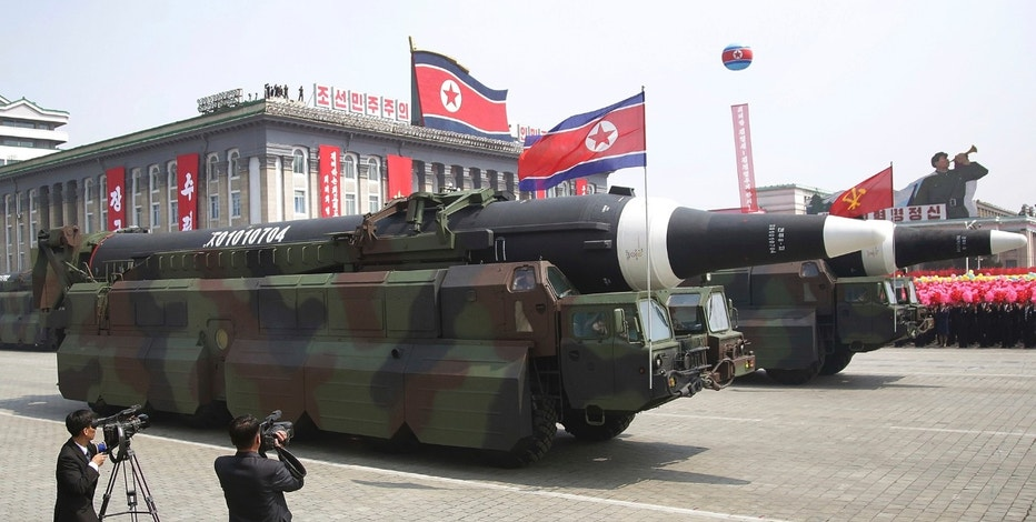 In what military experts say appears to be a North Korean KN-08 Intercontinental Ballistic Missile (ICMB) is paraded across Kim Il Sung Square during a military parade on Saturday, April 15, 2017, in Pyongyang, North Korea, to celebrate the 105th birth anniversary of Kim Il Sung, the country's late founder and grandfather of current ruler Kim Jong Un. Military analysts say the missiles could one day be capable of hitting targets as far away as the continental United States, although the North has yet to flight test them. (AP Photo/Wong Maye-E)