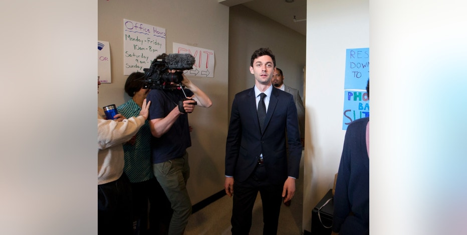 Democratic candidate for Georgia's Sixth Congressional seat Jon Ossoff talks with supporters at a campaign field office Tuesday, April 18, 2017, in Marietta, Ga. Voters began casting ballots on Tuesday in the special election to fill the House seat vacated by Health and Human Services Secretary Tom Price. (AP Photo/John Bazemore)
