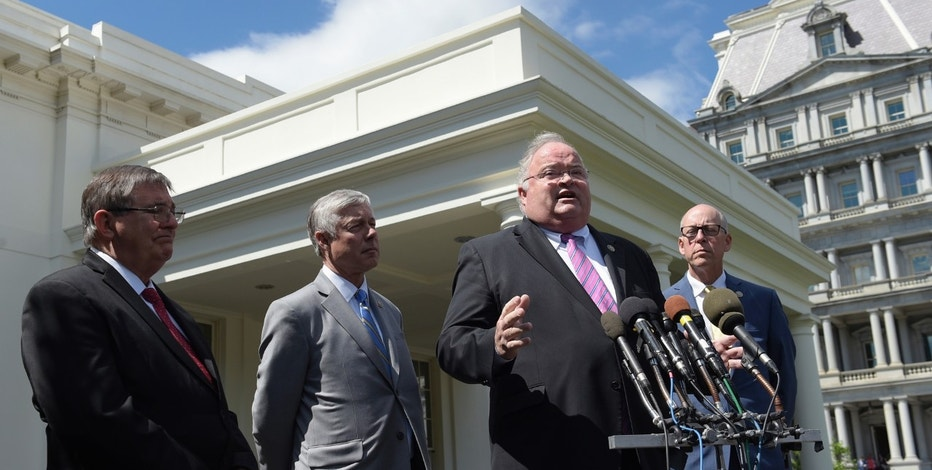 Rep. Billy Long, R-Mo., second from right, speaks to reporters outside the White House in Washington, Wednesday, May 3, 2017, following a meeting with President Donald Trump on health care reform. From left are, Rep. Michael Burgess, R-Texas, Rep. Fred Upton, R-Mich., and Rep. Greg Walden, R-Ore. (AP Photo/Susan Walsh)