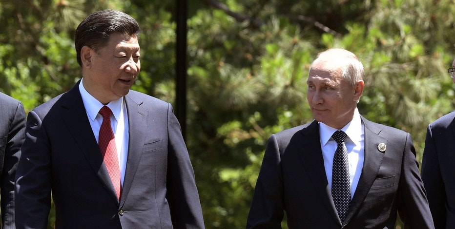 Russian President Vladimir Putin, right, and Chinese President Xi Jinping, left, walk prior to the opening ceremony of the Belt and Road Forum in Beijing, Sunday, May 14, 2017. (Alexei Nikolsky, Sputnik, Kremlin Pool Photo via AP)