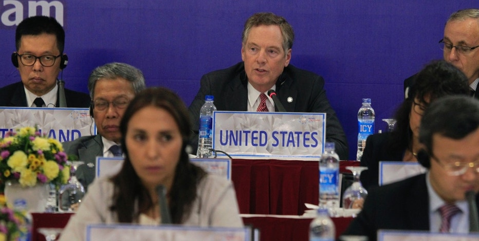U.S. Trade Representative Robert Lighthizer, center, speaks during a press conference after the Asia-Pacific Economic Cooperation (APEC) trade ministerial meeting in Hanoi, Sunday, May 21, 2017. The Pacific Rim trade ministers meeting in Vietnam have committed to move ahead with the Trans Pacific Partnership trade pact after the United States pulled out. (AP Photo/Hau Dinh)