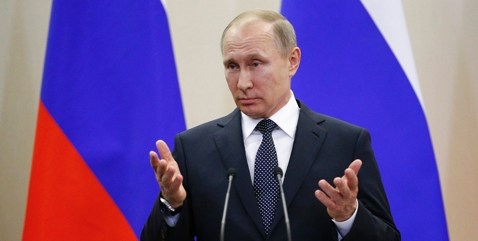 Russian President Vladimir Putin gestures as he speaks to the media after his talks with German Chancellor Angela Merkel at Putin's residence in the Russian Black Sea resort of Sochi, Russia, Tuesday, May 2, 2017. German Chancellor Angela Merkel has arrived in Russia for talks with President Vladimir Putin expected to focus on the unresolved conflict in Ukraine and the civil war in Syria. (AP Photo/Alexander Zemlianichenko, Pool)
