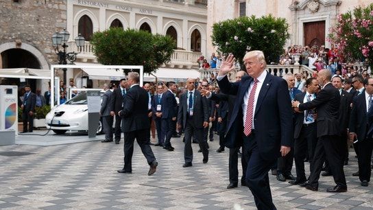 Trump ends nine-day overseas trip with a flourish as trouble looms at home