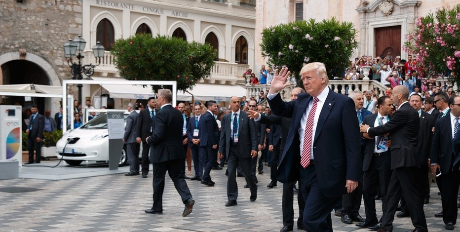 President Donald Trump waves as he takes a walking tour during the G7 Summit, Friday, May 26, 2017, in Taormina, Italy. (AP Photo/Evan Vucci)