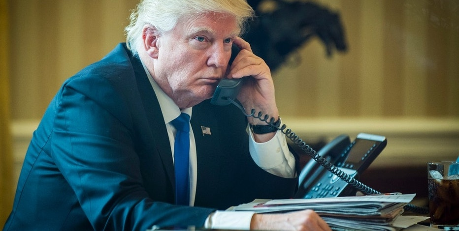 United States President Donald Trump speaks with President of Russia Vladimir Putin on the telephone in the Oval Office