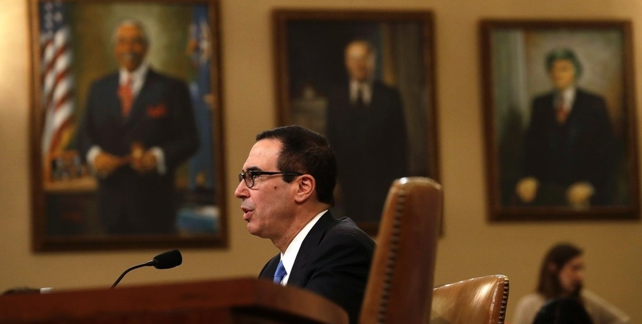 Treasury Secretary Steven Mnuchin testifies on Capitol Hill in Washington, Wednesday, May 24, 2017, before the House Ways and Means  Committee hearing on Treasury Department's fiscal year 2018 budget proposals. (AP Photo/Jacquelyn Martin)