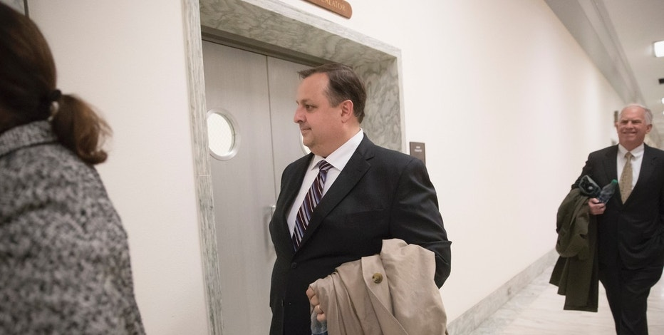 FILE - In this Jan. 23, 2017 file photo, Walter M. Shaub Jr., director of the U.S. Office of Government Ethics walks on Capitol Hill in Washington. Donald Trump's attorneys originally wanted him to submit an updated financial disclosure without certifying the information as true, according to correspondence with the Office of Government Ethics. Shaub said his office would only work with Dillon if she agreed to follow the typical process of having Trump make the certification. That is standard practice for the thousands of financial disclosure forms OGE processes each year.  (AP Photo/J. Scott Applewhite, File)