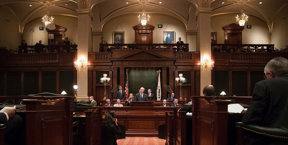 "FILE - In this Jan. 25, 2017 file photo, Illinois Gov. Bruce Rauner delivers speaks in the Illinois House chamber in Springfield, Ill. Illinois is on track to become the first U.S. state to have its credit rating downgraded to ""junk"" status, a move that will deepen a multibillion-dollar financial hole and cost taxpayers more for years to come. (Ted Schurter/The State Journal-Register via AP File)"