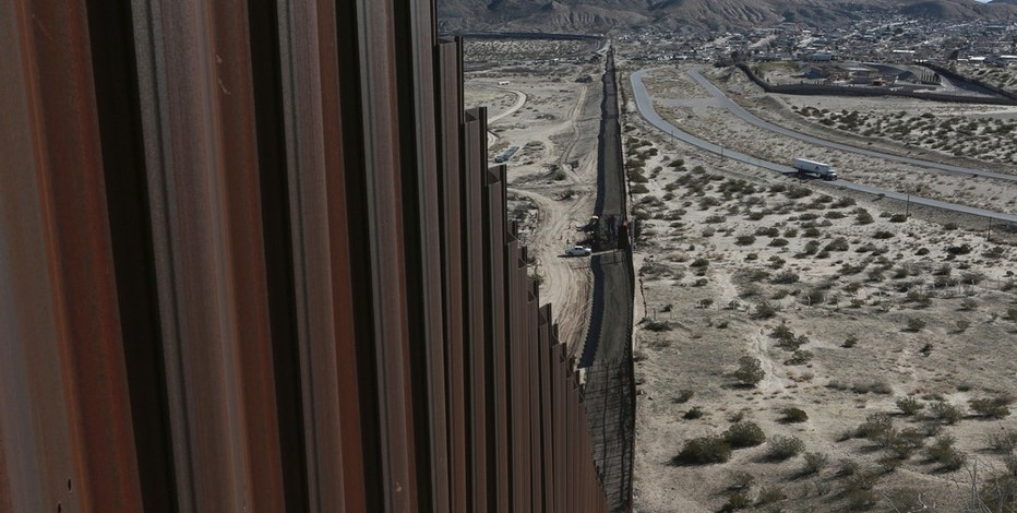 A truck drives near the Mexico-US border fence, on the Mexican side, separating the towns of Anapra, Mexico and Sunland Park, New Mexico, Wednesday, Jan. 25, 2017.  U.S. President Donald Trump will direct the Homeland Security Department to start building a wall at the Mexican border. (AP Photo/Christian Torres)