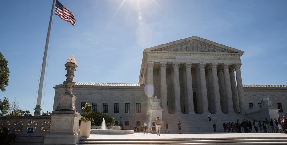 People visit the Supreme Court in Washington, Monday, June 26, 2017, as justices issued their final rulings for the term, in Washington. The high court is letting a limited version of the Trump administration ban on travel from six mostly Muslim countries take effect, a victory for President Donald Trump in the biggest legal controversy of his young presidency. (AP Photo/J. Scott Applewhite)