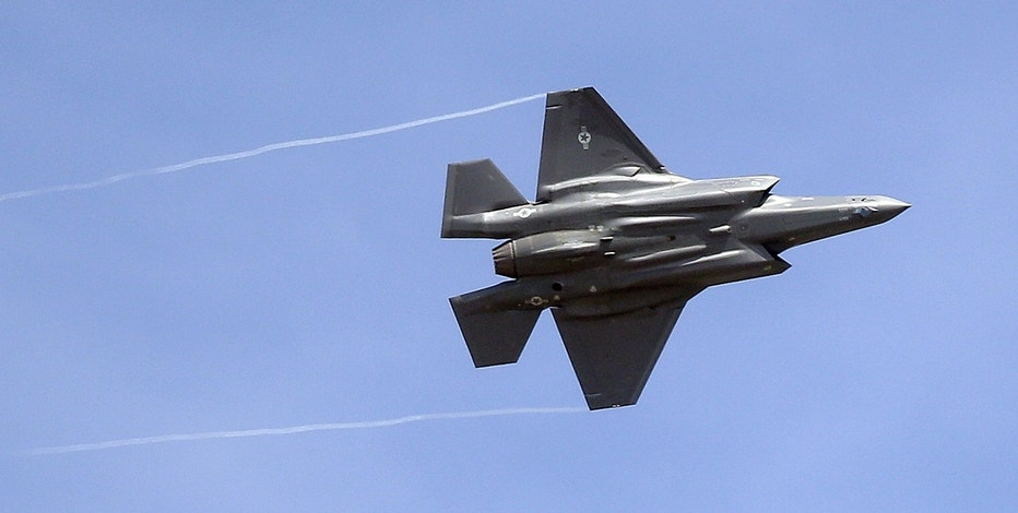 In this Wednesday, Sept. 2, 2015, file photo, an F-35 jet arrives at its new operational base at Hill Air Force Base, in northern Utah. Airbus and Boeing will again hog the spotlight at the Paris Air Show with their battle for ever-larger slices of the lucrative pie in the sky.