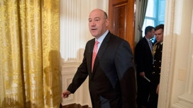 Trump adviser Cohn to remain as talk swirls of White House departures