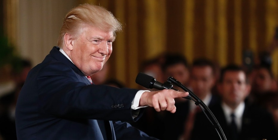 President Donald Trump points to the audience as he speaks in the East Room of the White House in Washington, Monday, June 5, 201.  Trump is making the case for privatizing the nation's air traffic control system.  (AP Photo/Carolyn Kaster)
