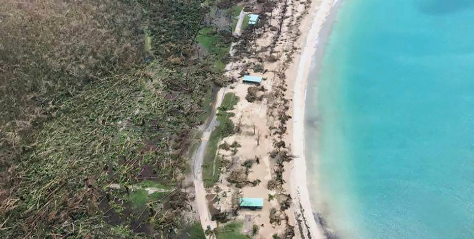CORRECTS DAY - This photo provided on Friday, Sept. 8, 2017, shows storm damage in the aftermath of Hurricane Irma in St. Thomas' Magens Bay in the U.S. Virgin Islands. Irma scraped Cuba's northern coast Friday on a course toward Florida, leaving in its wake a ravaged string of Caribbean resort islands strewn with splintered lumber, corrugated metal and broken concrete. (Caribbean Buzz Helicopters via AP)