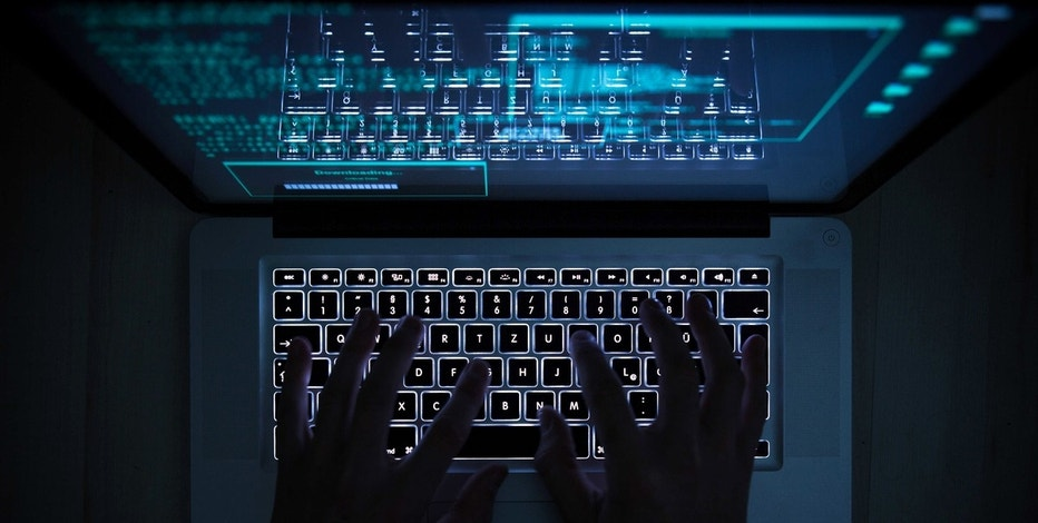 ILLUSTRATION - A man uses the illuminated keyboard of a laptop, the monitor of which is open to a hacking program in Rottweil, Germany, 12 November 2016. Photo by: Silas Stein/picture-alliance/dpa/AP Images