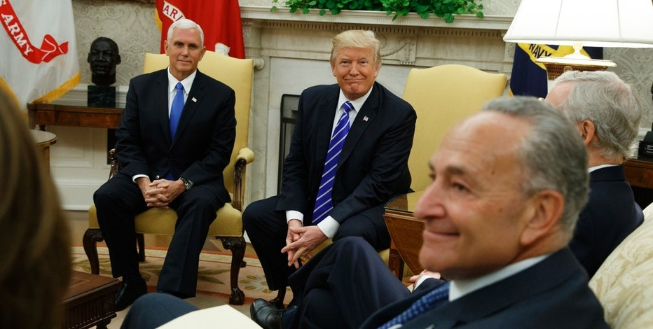 Vice President Mike Pence looks on with President Donald Trump during a meeting with Senate Minority Leader Chuck Schumer, D-N.Y., and other Congressional leaders in the Oval Office of the White House, Wednesday, Sept. 6, 2017, in Washington. (AP Photo/Evan Vucci)