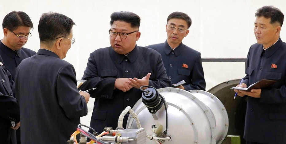 This undated file image distributed on Sunday, Sept. 3, 2017, by the North Korean government, shows North Korean leader Kim Jong Un at an undisclosed location. North Korea's latest nuclear test was part theater, part propaganda and maybe even part fake. But experts say it was also a major display of something very real: Pyongyang's mastery of much of the know-how it needs to reach its decades-old goal of becoming a full-fledged nuclear state.  The jury is still out on whether North Korea tested, as it claims, a hydrogen bomb ready to be mounted on an ICBM.  (Korean Central News Agency/Korea News Service via AP, File)
