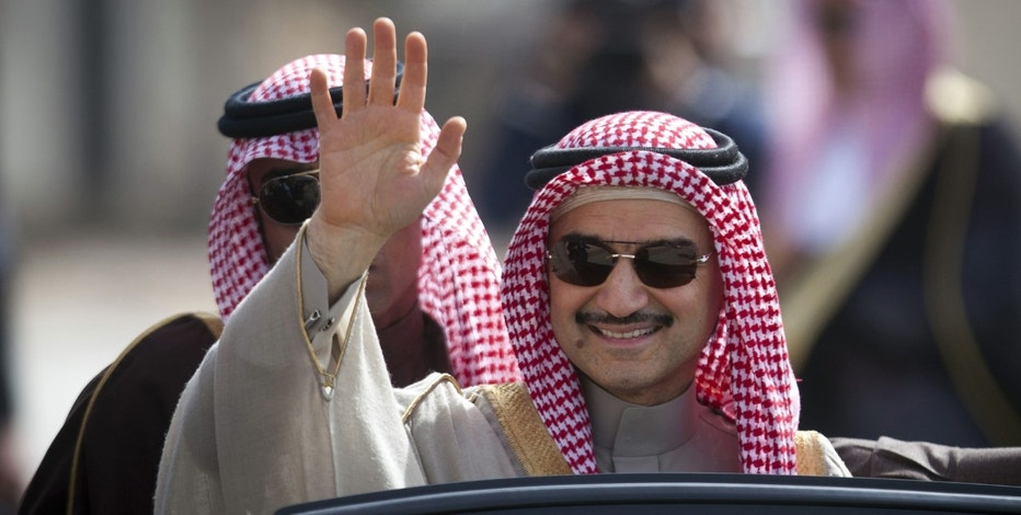 FILE - In this Feb. 4, 2014 file photo, Saudi billionaire Prince Alwaleed bin Talal, waves as he arrives at the headquarters of Palestinian President Mahmoud Abbas in the West Bank city of Ramallah. (AP Photo/Majdi Mohammed, File)