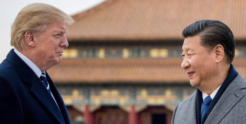 President Donald Trump and Chinese President Xi Jinping tour the Forbidden City, Wednesday, Nov. 8, 2017, in Beijing, China. (AP Photo/Andrew Harnik)