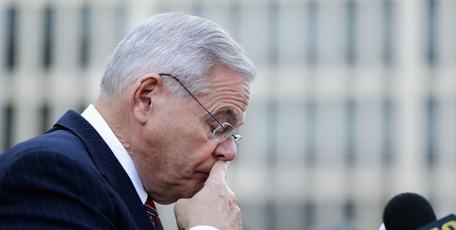 Democratic Sen. Bob Menendez pauses to compose himself before speaking to reporters in front of the courthouse in Newark, N.J., Thursday, Nov. 16, 2017.