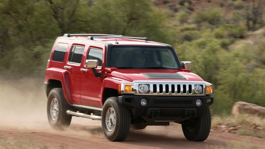 FILE - In this undated photo provided by General Motors a 2006 Hummer H3 is driven. General Motors said Wednesday, May 5, 2010, that it is recalling all Hummer H3s produced since the 2006 model year to fix a portion of the hood that can detach during driving. Hummer spokesman Nick Richards said a device on the hood called a hood louver can come loose and possibly detach while driving. (AP Photo/General Motors, File) ** NO SALES **