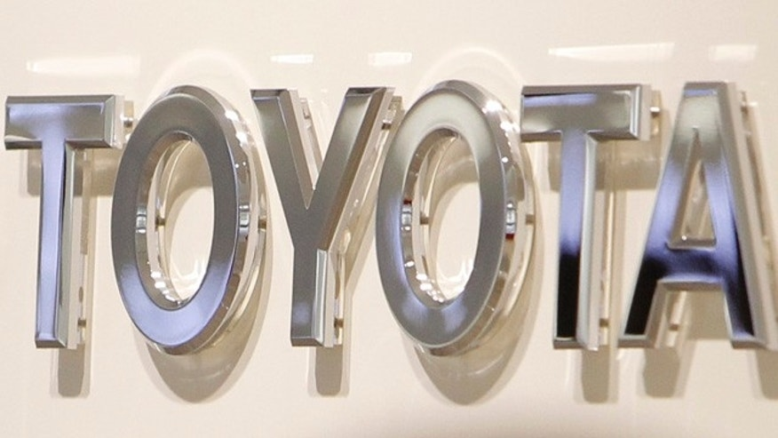 Feb. 2: The corporate sign of Toyota Motor Corp. is seen at a showroom of the Japanese automaker in Nagoya, central Japan.