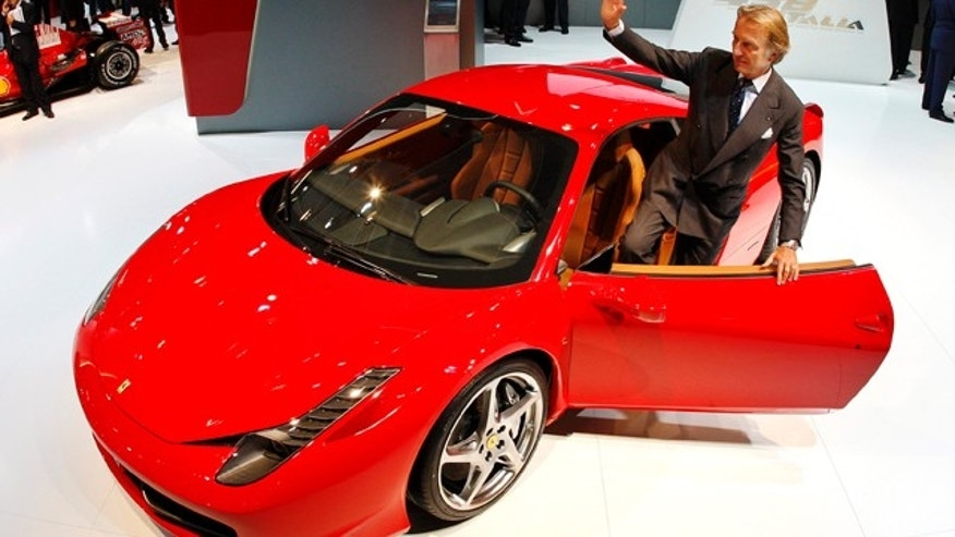 President of Fiat group Luca di Montezemolo stands next to a Ferrari 458 Italia