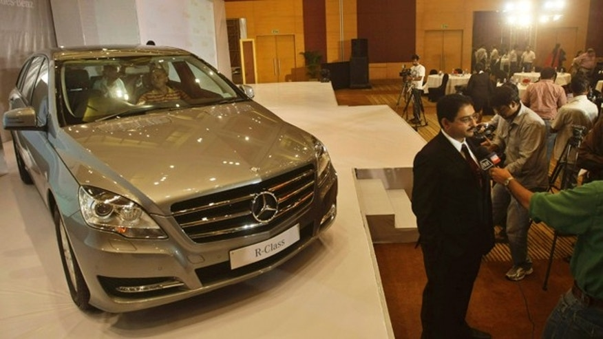 Oct. 7: Mercedes-Benz India Director Sales and Marketing Debashis Mitra, wearing black, speaks with a member of the media during the launch of the premium multi-purpose vehicle Mercedes-Benz R-Class, in Mumbai, India.