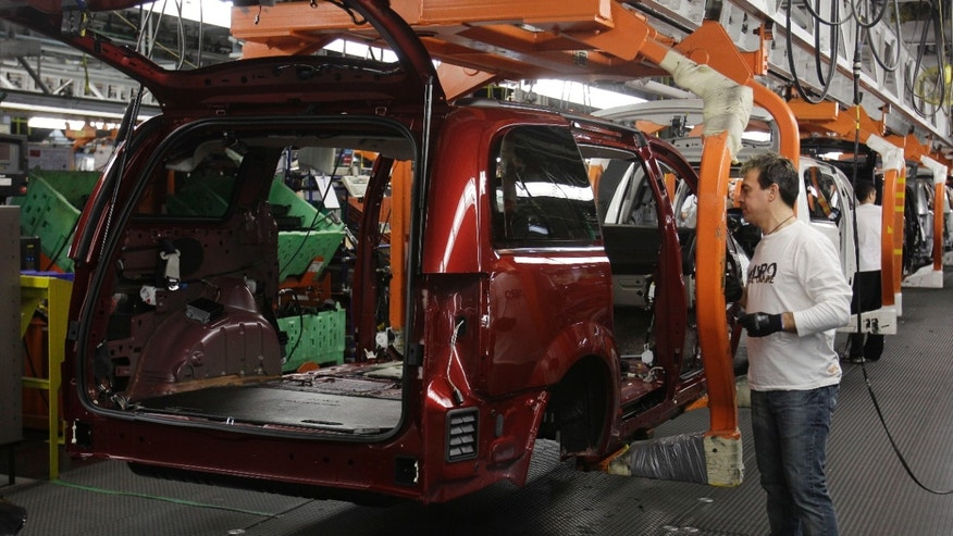 Assemble the 2011 Dodge Grand Caravan and Chrysler town & country at the Windsor Assembly Plant in Windsor, Ontario, Tuesday, Jan. 18, 2011. (AP Photo/Carlos Osorio)
