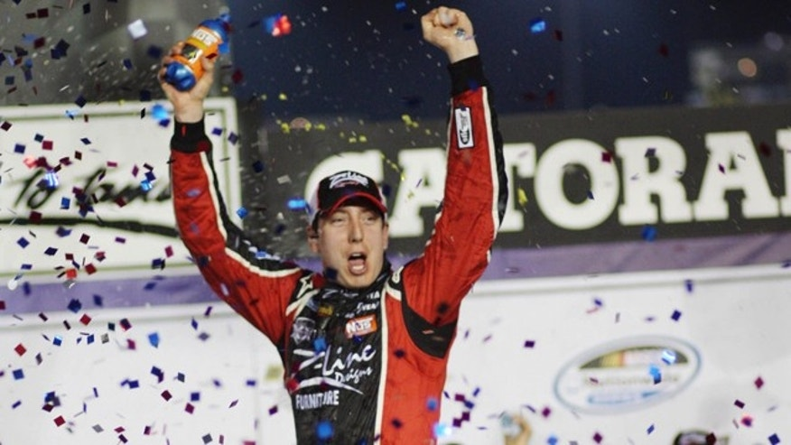 May 6: Kyle Busch raises his arms in victory lane after winning the NASCAR Nationwide Series auto race at Darlington Raceway in Darlington, S.C.