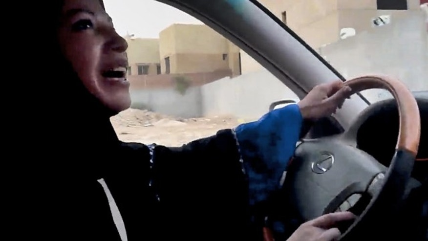 In this image made from video released by Change.org, a Saudi Arabian woman drives a car as part of a campaign to defy Saudi Arabia's ban on women driving, in Riyadh, Saudi Arabia Friday, June 17, 2011. Several Saudi women boldly got behind the wheel Friday, including one who managed a 45-minute trip through the nation's capital, seeking to ignite a road rebellion against the male-only driving rules in the ultraconservative kingdom. (AP Photo/Change.org)