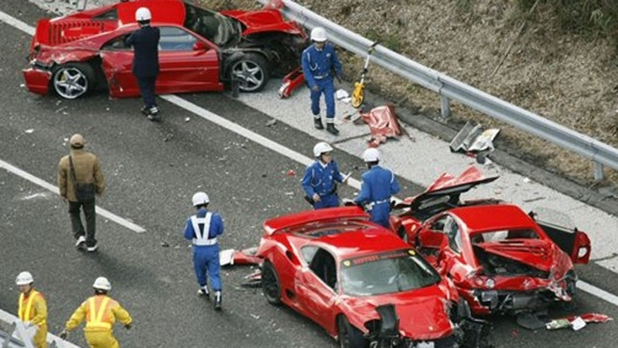 December 4, 2011: Police officers investigate damaged Ferrari cars at the site of a traffic accident on the Chugoku Expressway in Shimonoseki, southwestern Japan.