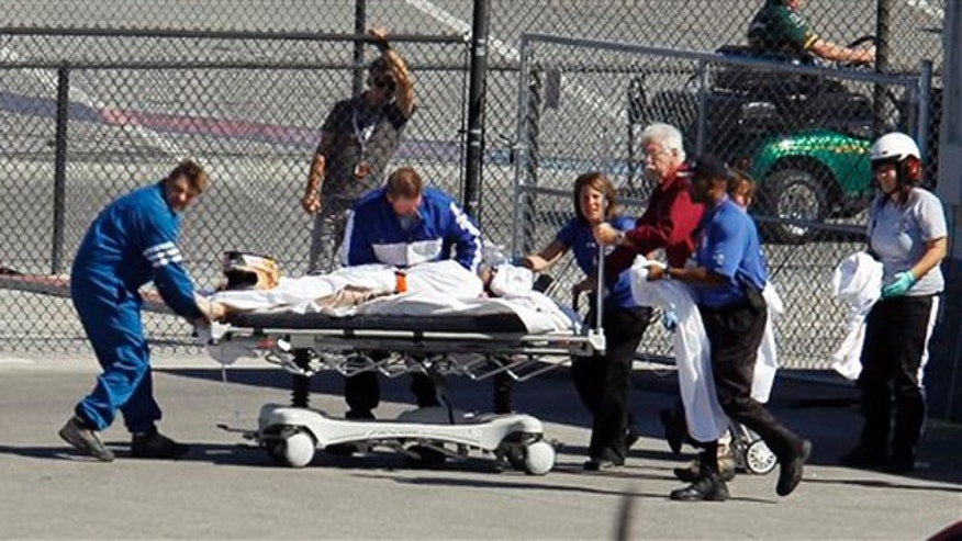 Dan Wheldon, of England, is transported to a medical helicopter following a crash early in the IndyCar Series' Las Vegas Indy 300 auto race Sunday, Oct. 16, 2011, in Las Vegas.