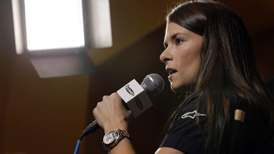 Danica Patrick answers a question at a news conference during the NASCAR Media Tour in Concord, N.C., Monday, Jan. 23, 2012. Patrick will not run in the Indianapolis 500 this season and instead will drive in the Coca-Cola 600, NASCAR's longest race of the year. (AP Photo/Chuck Burton)