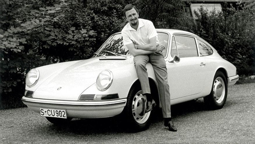 In this publicly released 1990 black and white  file photo provided by Porsche AG, Car designer Ferdinand Alexander Porsche is photographed 1963 with a Porsche 901.