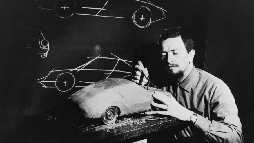 In this publicly released 1968 black and white  file photo provided by Porsche AG, Car designer Ferdinand Alexander Porsche is photographed at unknown place with a model of the Porsche 911.