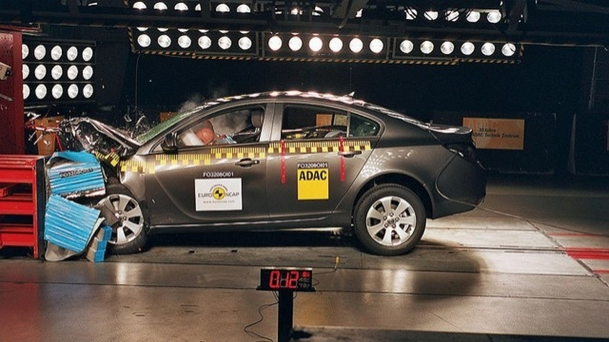 An Opel Insignia, similar to the Vauxhall Insignia, undergoes crash testing.
