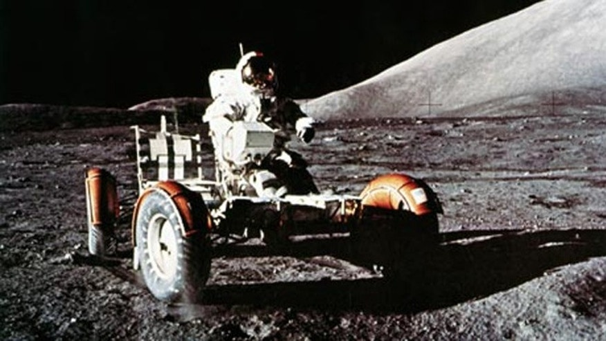Eugene Cernan takes the LRV out for a test drive before loading on communications equipment and gear.