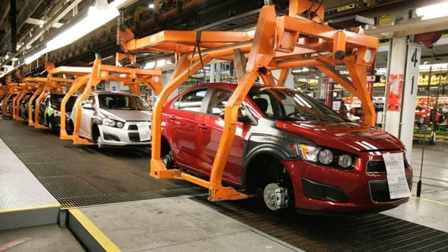 In this April 25, 2012 photo, Chevrolet Sonics move down the line at the General Motors Orion Assembly plant in Orion Township, Mich. Nearly four years after GM filed for bankruptcy protection, the automaker is building the Sonic, the best-selling subcompact car in the nation. It's a vehicle no one thought could be made profitably in the U.S., by a company that few people thought would last. (AP Photo/Duane Burleson)